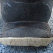 Back view, sole is wider at the base than the shoe itself