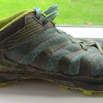 Side view, showing the high upper across the front of the shoe