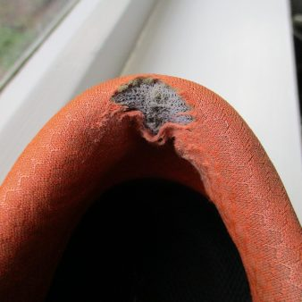The inside of the heal has worn right through